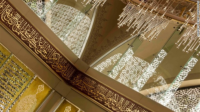"Rather than walls, huge windows covered in intricate metalwork allow light to stream in, ""caressing you much like the pages of the Koran,"" explained Fadillioglu."