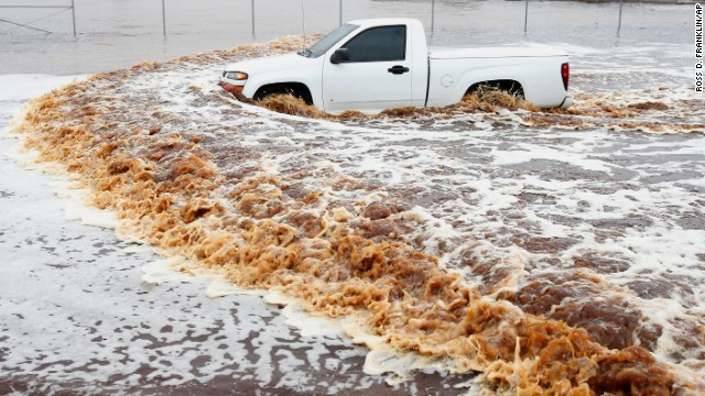 A truck creates a wake as its driver tries to make it through a severely flooded street in Phoenix on Monday, September 8. Arizona's governor declared a statewide emergency as <a href='http://www.cnn.com/2014/09/08/us/arizona-flooding/index.html'>record-setting rains flooded numerous Phoenix-area roadways and forced some schools to shut down.</a>
