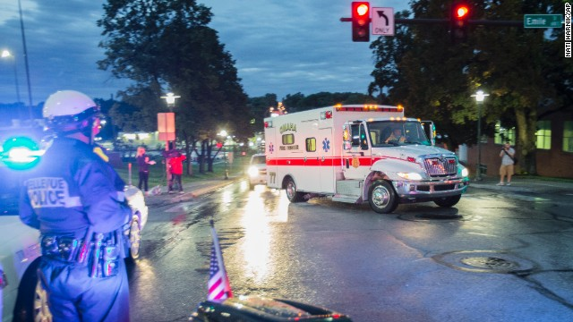 An ambulance transporting Dr. Rick Sacra, an American missionary who was infected with Ebola in Liberia, arrives at the Nebraska Medical Center in Omaha, Nebraska, on Friday, September 5. Sacra was being treated in the hospital's special isolation unit.