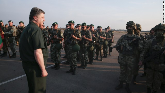 Ukrainian President Petro Poroshenko, left, inspects military personnel during a visit to Mariupol on Monday, September 8.