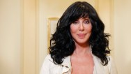 "A virus is forcing Cher to postpone the opening of the second leg of her ""Dressed to Kill"" tour this week."