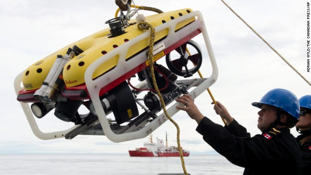A crew member of the HMCS Kingston loads an remote underwater vehicle, part of the Victoria Strait Expedition, as seen in an August 24 photo.