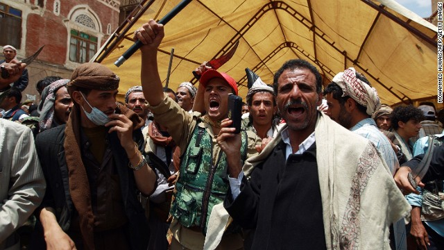 Yemeni Shiite Houthi anti-government protesters near the government headquarters in Sanaa on September 9, 2014.