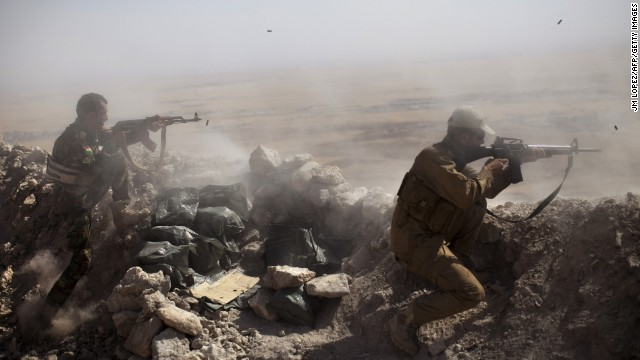 Kurdish Peshmerga fighters fire at ISIS militant positions from their position on the top of Mount Zardak, east of Mosul, Iraq, on Tuesday, September 9.