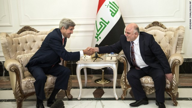 U.S. Secretary of State John Kerry, left, shakes hands with new Iraqi Prime Minister Haider al-Abadi after a meeting in Baghdad, Iraq, on Wednesday, September 10. Kerry is in the Mideast this week to discuss ways to bolster the stability of the new Iraqi government and combat ISIS.