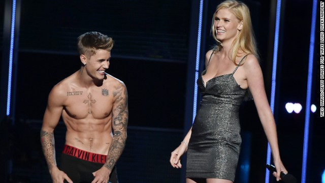 "Justin Bieber is a documented fan of public shirtlessness and <a href='http://www.mtv.com/news/1712168/justin-bieber-sings-naked-grandmother/' target='_blank'>singing songs to his grandmother in the nude</a>. We can now also call the ""Baby"" singer a fan of the public striptease. At the 2014 charity event Fashion Rocks, Bieber removed everything but his underwear while on stage with co-presenter Lara Stone, explaining that he just didn't feel comfortable unless he was in his ""Calvins."""