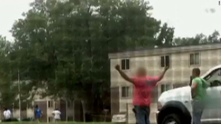 Witnesses: Michael Brown's hands were up