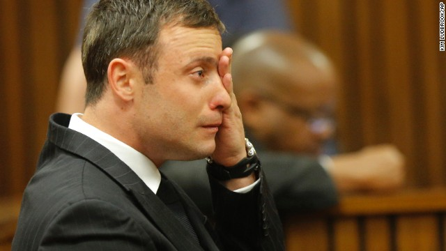 Pistorius cries on the stand in Pretoria on Thursday, September 11, as Masipa reads notes while delivering her verdict in Pistorius' murder trial.