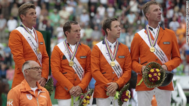The Dutch team stayed up to win the men's jumping competition. Pictured are coach Rob Ehrens, Jeroen Dubbeldam, Gerco Schroder, Maikel van der Vleuten and Jur Vrieling.