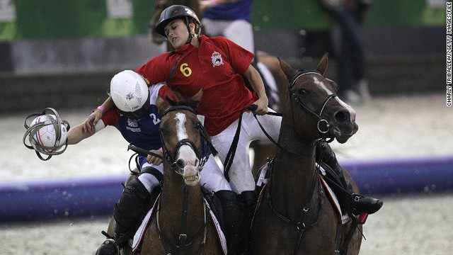 A little less graceful is the unusual sport of horse-ball. Here, France's Cecile Guerpillonand Spain's Laura Font go head-to-head.