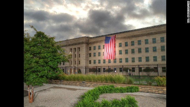 WASHINGTON: Remembering 9/11... An American flag hangs down the side of the Pentagon on the 13th anniversary of the September 11th terrorist attacks that killed nearly 3,000 people at the World Trade Center, Pentagon and on Flight 93. Photo by CNN's Bill Alberter. Follow Bill (@billalberter) and other CNNers along on Instagram at instagram.com/cnn.