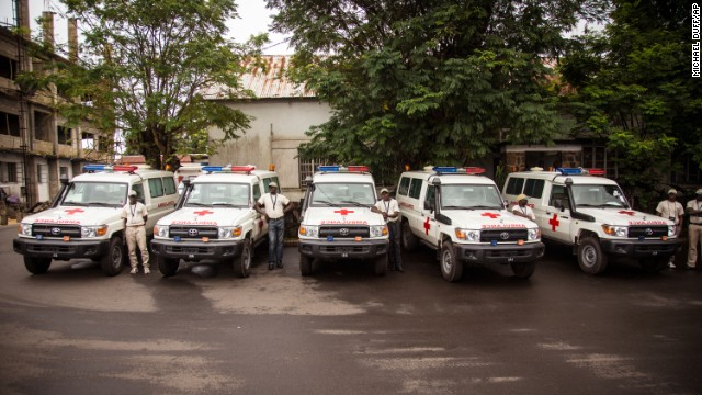 Five ambulances that were donated by the United States to help combat the Ebola virus are lined up in Freetown, Sierra Leone, on September 10 following a ceremony that was attended by Sierra Leone President Ernest Bai Koroma.