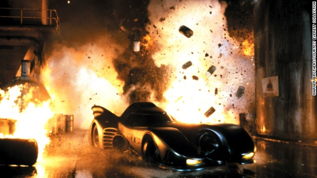 """In 1989's """"Batman,"""" the superhero came zooming onto the big screen in a sleek, speedy ride befitting of a Dark Knight (played by Michael Keaton). Controlled by voice, this Batmobile wasn't just about looks; it was also tough thanks to its protective shields."""