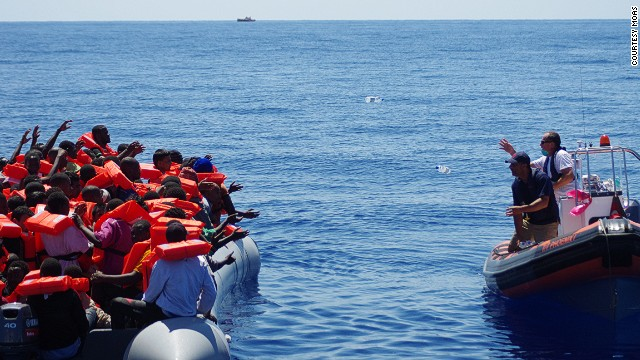 "A lifeboat from rescue ship ""Phoenix"" approaches refugees, offering drinking water. We never approach a boat with our boat because it's rather big, so we approach cautiously with a dingy. The first thing we do is start giving out life jackets,"" said MOAS director Martin Xuereb."