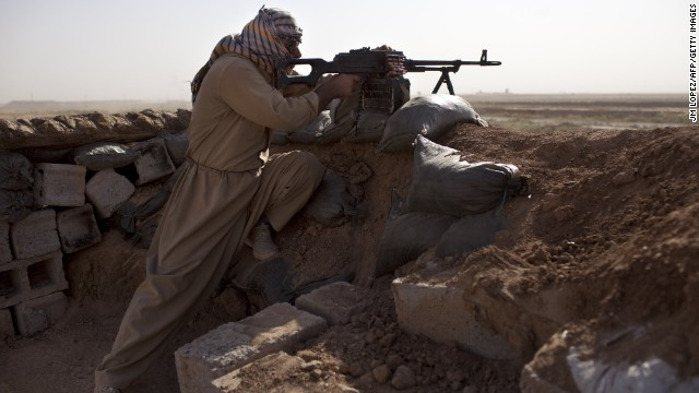 A Kurdish Peshmerga fighter holds a position Thursday, September 11, in Yangije, Iraq, where heavy clashes against ISIS fighters took place the previous night. The ISIS militant group has taken over large swaths of northern and western Iraq as it seeks to create an Islamic caliphate that stretches from Syria to Iraq.