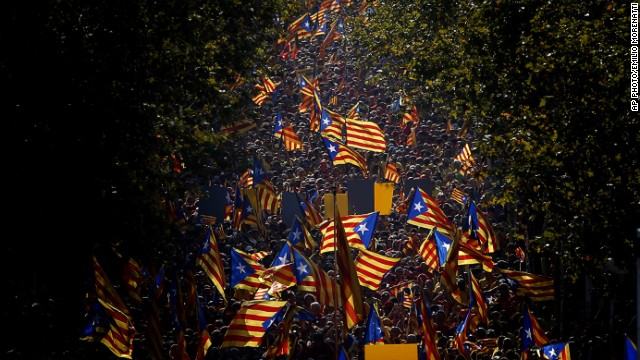 "SEPTEMBER 11 - BARCELONA, SPAIN: People wave Catalan ""Estelada"" flags during a demonstration calling for the independence of Catalonia. A week before<a href='http://cnn.com/2014/09/10/world/europe/uk-scottish-independence/index.html'> Scotland votes on whether to break away from the United Kingdom,</a> separatists in northeastern Spain are demanding a secession sentiment vote."