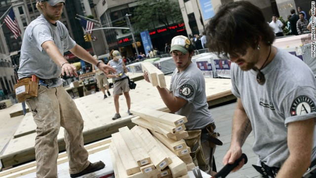AmeriCorps volunteers Phil Tritz, Jeff Schwartz and Matt Swan build homes for Hurricane Katrina victims in New York in 2005.