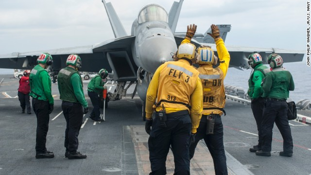 An F/A-18E Super Hornet from the Sunliners of Strike Fighter Squadron 81 taxis onto a catapult prior to launching from the flight deck of the aircraft carrier USS Carl Vinson. Two F/A-18s flying from the carrier crashed into the Pacific Ocean, the Navy said on Friday, September 12.