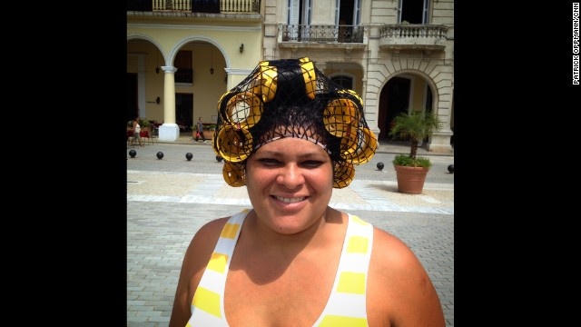 "HAVANA, CUBA: Leticia was very kind and stopped when I asked to take her photograph. She seemed puzzled though and wondered why I wanted a picture of her. When I said I liked her homemade rollers, she turned bright red and told me ""I forgot I had them on!"" - CNN's Patrick Oppmann. Follow Patrick (@cubareporter) and other CNNers along on Instagram at instagram.com/cnn."