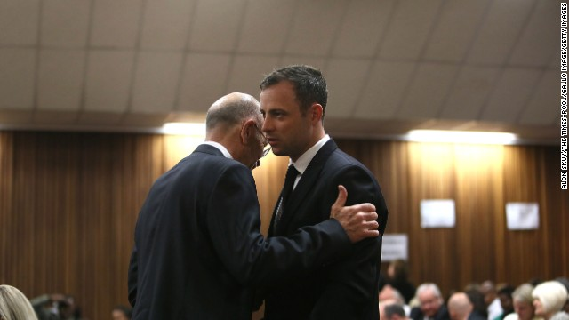Oscar Pistorius speaks with his uncle Arnold Pistorius during his trial at the Pretoria High Court on September 12, in Pretoria, South Africa. Judge Thokozile Masipa cleared Pistorius of premeditated murder, but he was found guilty of culpable homicide. The first double-amputee runner to compete in the Olympics was accused of intentionally killing his girlfriend, Reeva Steenkamp, in February 2013. The athlete admits killing Steenkamp but says he mistook her for a burglar and thought he was defending himself.