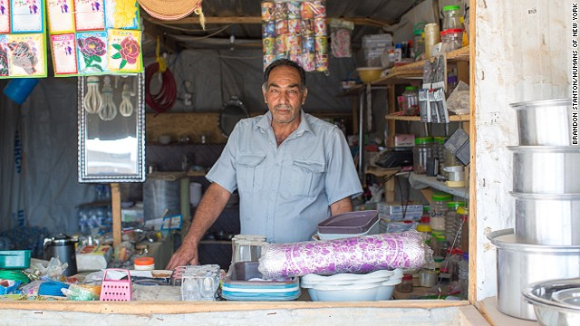 """Back in Syria, I sold antiques and Orientals. I had all sorts of things in my shop: glass vases, old stamps, coins from the Roman and Ottoman empire, valuable laces, antique furniture. But they beat me with rifles and knocked out my teeth. Then they burned my store to the ground."""