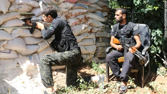 Syrian opposition fighters take position behind sandbags in Aleppo, Syria, on Thursday, September 11.