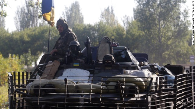 Ukrainian soldiers ride on an armored vehicle near the eastern Ukrainian city of Kramatorsk, in the Donetsk region, on September 13.
