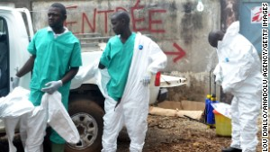 Members of a volunteer medical team wear protective gear before the burying the body of an Ebola victim in Conakry, Guinea on September 13.