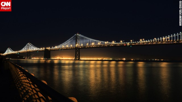 "The San Francisco-Oakland Bay Bridge illuminates the San Francisco Bay in California. <a href='http://ireport.cnn.com/docs/DOC-1064986'>Paul Heller</a>, who shot this photo in November 2013, described it as ""a beautiful scene."""