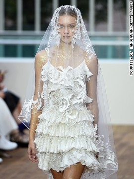 An ultra-feminine theme was created with delicate lace and white chiffon.