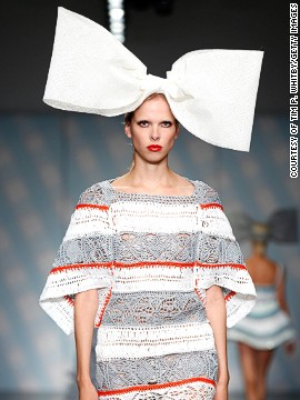 Each model balanced a huge bow on their heads <a href='http://www.cnn.com/2014/09/17/world/london-fashion-week-memorable-fashion/index.html?hpt=hp_c3'>whilst walking the runway</a>.
