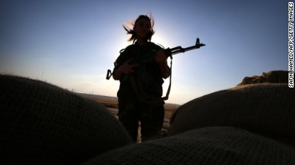 An Iranian Kurdish female member of the Freedom Party of Kurdistan (PAK) keeps a position in Dibis, some 50 kms northwest of Kirkuk, on September 15, 2014. The world's top diplomats pledged today to support Iraq in its fight against Islamic State militants by