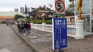 City tests sidewalk lane for phone addicts