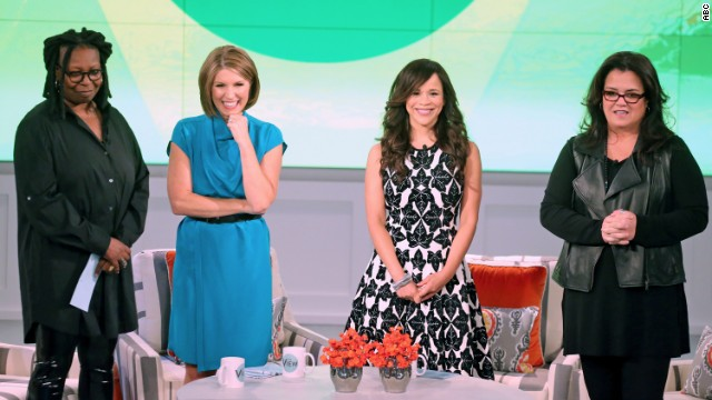 """The View's"" Whoopi Goldberg, left, and Rosie O'Donnell, right, share their weight-loss news on the show's season premiere. Goldberg has lost 35 pounds, and O'Donnell, inspired to take action after a heart attack two years ago, has lost more than 50. Nicolle Wallace, second from left, and Rosie Perez are new co-hosts on the show."