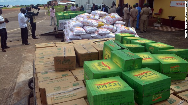 Boxes of aid, donated by Ghana's President and the chairman of the Economic Community Of West African States, sit in an airport in Conakry, Guinea, on September 15.
