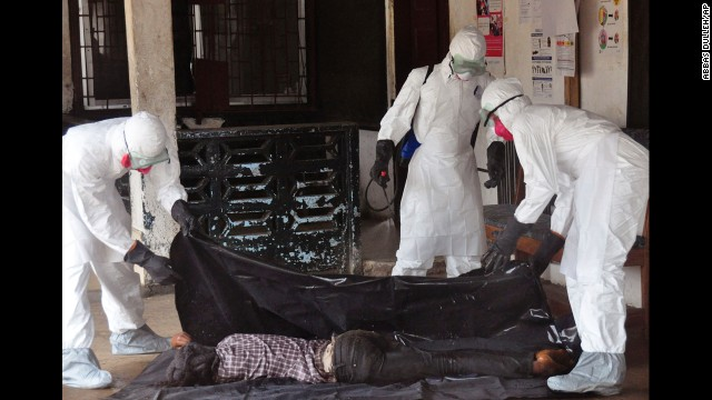 Health workers in Monrovia, Liberia, move the body of a person who they suspect died from the Ebola virus on Tuesday, September 16.