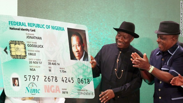 Nigerian President Goodluck Jonathan looks at the replica of his electronic identity card during the launching of the cards in Abuja on August 28.