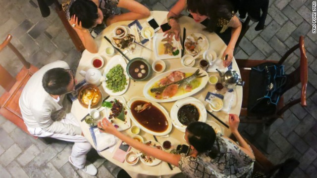 In Shanghai, the traditional way to eat is family style.