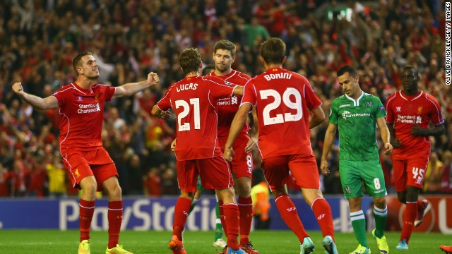 """Gerrard is mobbed after securing victory for Liverpool over Ludogorets and later told ITV: """"It's always nice to win a game, especially when you think you're going to drop two points. The game as a whole, we didn't do better than OK and have a lot to learn."""""""