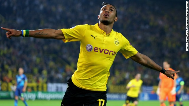 Pierre-Emmerick Aubameyang celebrates scoring Borussia Dortmund's second goal as it beat English side Arsenal 2-0 in Germany.