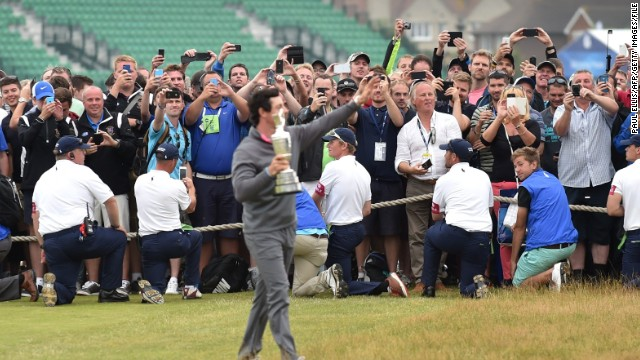 Spectators try to get a snap of McIlroy after his British Open win at Hoylake. Wifi was available throughout the course for the second year running and will be at the 2014 Ryder Cup in Scotland, with spectators encouraged to share their thoughts and pictures on social media.