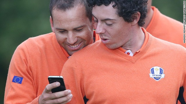 McIlroy and Sergio Garcia check out something amusing on the Spaniard's mobile phone during a practice day ahead of the 2012 Ryder Cup, won in dramatic fashion by Europe.