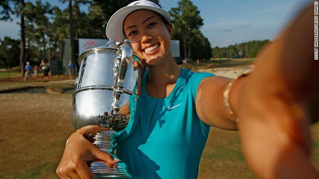 Michelle Wie, who has played in the U.S. Solheim Cup team, takes a selfie after she won her first major title -- the 2014 U.S. Women's Open.