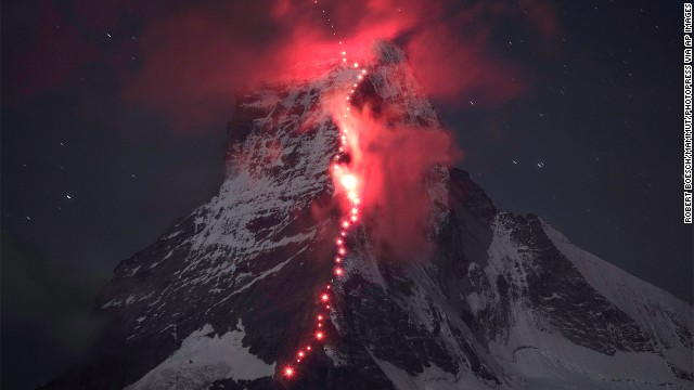 SEPTEMBER 17 - ZERMATT, SWITZERLAND: Matterhorn, one of the highest peaks of the Swiss Alps, is illuminated by the torch lights of climbers celebrating the 150th anniversary of the first ascent of the mountain. Matterhorn is popular worldwide and regarded as the emblem of the Alps.