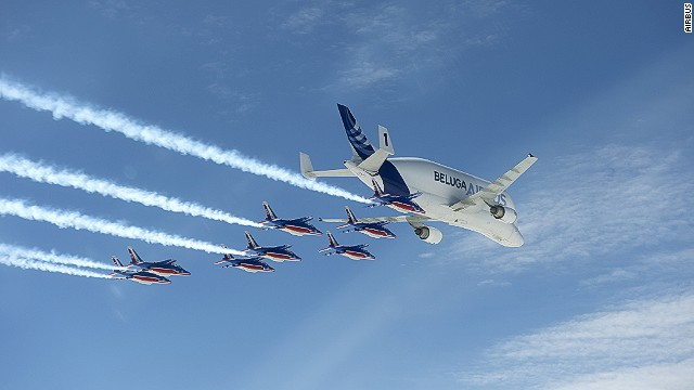 "Airbus' Beluga transporter aircraft took part in a formation flight with the French Air Force's ""Patrouille de France"" aerobatic demonstration team in May 2014."