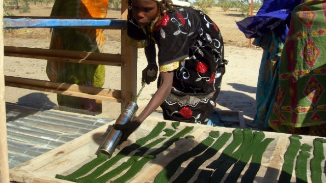 Pictured, a lake community in Chad dries-out the algae spirulina for consumption. The high-protein cyanobacterium is used by many populations, is now common in health food supplements and can be grown in space for use in meals.