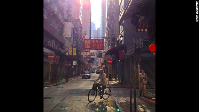 "HONG KONG: ""Morning light in Sheng Wan district. Around here delivery men still ride bicycles but this old neighborhood is changing. A lot of boutique hotels are opening up and rental prices are sky high. I saw that a 350 sq ft apartment is about USD $2000."" - CNN's Brad Olson, September 18. Follow Brad (@cnnbrad) and other CNNers along on Instagram at instagram.com/cnn."