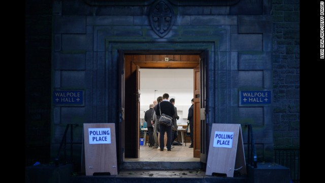 People wait to cast ballots inside a polling station in Edinburgh on September 18.