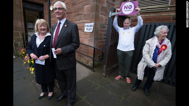 Darling, second from left, stands with his wife, Maggie, outside a polling station in Edinburgh on September 18.