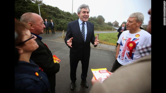 Former British Prime Minister Gordon Brown talks to pro-union campaigners outside a polling station in Queensferry, Scotland, on September 18.
